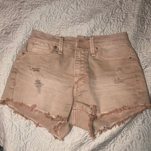 Rustic dusty pink ripped shorts
